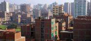 التداخل بين الاسكان الرسمى و اللارسمى (الجيزة- منطقة فيصل)